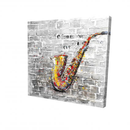 Graffiti of a saxophone on brick wall